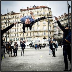 learning to fly (D750PB) Tags: artiste rue acrobat marseille port street artist acrobate jump saut