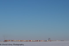 The Sky's the Limit for CN 115 (Going Trackside Photography) Tags: canadian national railway canada alberta huxley three hills subdivision cn rail cnr intermodal sky grain elevator terminal snow blue