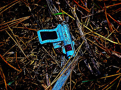 Alien Technology (Steve Taylor (Photography)) Tags: raygun toy gun lost dropped dumped pineneedles digitalart contrast brown blue black yellow wood newzealand nz southisland canterbury christchurch lines bottlelakeforest