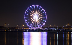 The Capital Wheel - National Harbor (Radical Retinoscopy) Tags: nightphotography nationalharbor oxenhill ferriswheel reflection harbor canont6s canon50mmf14 potomac river lowlight lowlightphotography capitalwheel