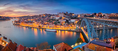 Porto. (Rudi1976) Tags: porto portugal panoramic city luisbridge panorama river cityscape water architecture sky outdoor skyline bridge reflection travel landscape europe traveldestination landmark tourism view building urban boat town douroriver downtown dusk sunset twilight historical traditional riverside riverbank unesco historic old port waterfront aerial