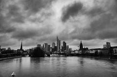 Frankfurt, Skyline over river Main (rgiw) Tags: deutschland city street blackwhite bw schwarzweiss sw colour farbe stadt monochrome skyscraper wolkenkratzer strasse building gebäude ricohgrii hessen frankfurt blackandwhite bauwerk architektur architecture