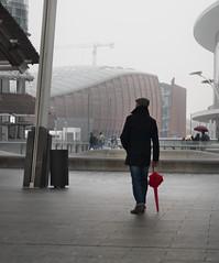 Shake this grayness (ndrearu) Tags: milan milano street outdoor gray city clouds rain umbrella red hat winter buildings