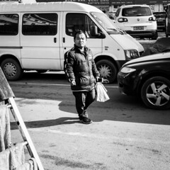 Always expect the unexpected (Go-tea 郭天) Tags: qingdao shandong républiquepopulairedechine cn huangdao portrait man alone lonely walk walking sun sunny shadow cars plastic bag cold winter little small dwarf unexpected street urban city outside outdoor people candid bw bnw black white blackwhite blackandwhite monochrome naturallight natural light asia asian china chinese canon eos 100d 24mm prime mobile phone cell cellular