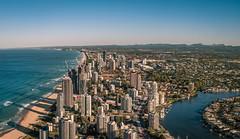 Australia - Gold Coast (Rafael Zenon Wagner) Tags: panorama 50mm afternoon nachmittag sonne sonnenuntergang sundown light licht hochhaus skyscrapers wasser water waves wellen ozean ocean gold golden