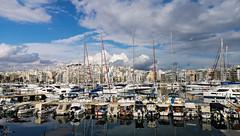 Pasalimani - Piraeus (athanecon) Tags: piraeus pireas pasalimani zea marina yaughts sailingyaughts attica greece sky clouds sea masts city urban reflection