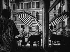 Gondoliers (mcook1517) Tags: visualart gondoliers city cityscape cityphotography people venice italy italia travel europe umbrella rest talking reflections geometry shapes stripes venezia