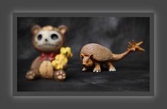 Planning his next meal (N.the.Kudzu) Tags: tabletop stilllife toys funkopop dinosaur furrybones resin figurine predator prey canondslr lensbabyedge50 photoscape frame home
