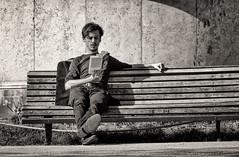 'Raskolnikov' (Canadapt) Tags: man street portrait bench shadow book reading bw toned lisbon portugal canadapt raskolnikov dostoevsky castaneda