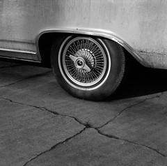 Portland (austin granger) Tags: portland wheel hubcap sidewalk crack jetstar spokes square film gf670