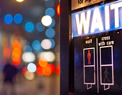 The Waiting Game (DobingDesign) Tags: bokeh redwhiteblue orange lights streetphotography traffic trafficlights crossing wait signage text words colours colourful dirty streetdirt mucky filth depthoffield bright hues reds