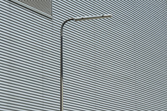 Street light and grey wall (Jan van der Wolf) Tags: map185136v grey grijs lines lijnen lijnenspel playoflines interplayoflines streetlight streetlamp straatlantaarn composition comp simple simpel minimalism minimalistic minimalisme minimal minimlistic pole paal monochrome monochroom wall muur facade gevel