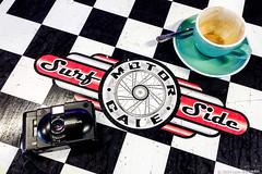 camera and coffee #140230337 (lynnb's snaps) Tags: motog3 surfsidemotorcafe cafe cameraandcoffee cellphones colour digital table check pattern cup coffee camera graphic 2019 sydney australia olympusxa4