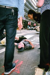 After The Crash - The Chicagoans Series (cpplunkett) Tags: biker bicyclist bicycle crash accident thechicagoans chicago film disposablecamera theloop candid urban streetphotography street bikelane downtown colorst hcsp streetfight