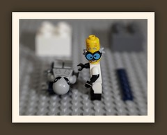 Roswell, New Mexico, Area 51 ... A scientist examines the body of a 'Grey Alien'. The body and wreckage of a UFO were discovered by a farmer in a nearby field. Both were immediately taken into custody by the Military. (N.the.Kudzu) Tags: tabletop toys stilllife lego minifigures grey alien madscientist canoneosm lensbabysol45 lightroom photoscape frame