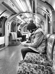 Acts Of Isolation (R~P~M) Tags: train railway londonunderground centralline 1992stock art artontheunderground michaellandy actsofkindness london england uk unitedkingdom greatbritain people sit sitting seated