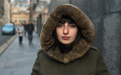 Ilaria from Policoro in southern Italy (Charles Hamilton Photography) Tags: streetportrait portrait glasgow virginiastreet glasgowstreetphotography faceinthecity peopleinthecity stranger hood december decemberlight shoppers eyecontact naturallight primelens nikond750 italiangirl colourstreetportrait charleshamilton