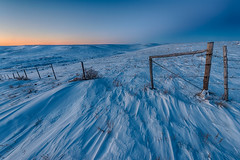1812_1658 Fence in Winter Afterglow (wild prairie man) Tags: landscape winter snow fence barbedwire barbwire blue sunset afterglow cold windswept beautiful shadows snowy wild northern prairie fenceline neardark hdr valmarie saskatchewan canada copyrighted jamesrpage