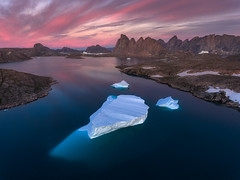 Midnight Sun in Scoresby Sound (Iurie Belegurschi www.iceland-photo-tours.com) Tags: scoresbysound greenland fjord midnightsun summer iceberg icebergs mountain mountains mountainrange sunset sunrise pink blue water aerial aerialphotography aerialphoto adventure arctic beautiful birdseyeview cloudy clouds cold coastal dreamscape dji djimavicpro2 earth enchanting extremeterrain extreme ecosystem fineartlandscape fineart fineartphotography fineartphotos finearticeland guidedphotographyworkshops guidedphotographytour guidedtoursiceland guidedtoursiniceland icelandphototours iuriebelegurschi sky landscape landscapephotography landscapephoto landscapes landscapephotos longexposure nature outdoor outdoors ocean phototours phototour photographyworkshopsiniceland tranquil serene seascape sea tours travelphotography travel view workshop workshops frozen freezing