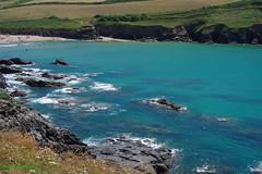 3KB07591a_C (Kernowfile) Tags: pentax cornwall cornish poldhucove beach sand water foam waves rocks cliffs hills grass bushes people thelizardpeninsula cove