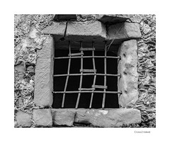 Crosslinked (agianelo) Tags: metal window bar rusted stone monochrome bw bn blackandwhite