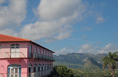 The Pink Hotel (peterkelly) Tags: digital canon 6d cuba gadventures cubalibre viñalesvalley pink hotel blue sky clouds windows mogotes northamerica palm tree limestone balcony