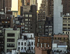 "Architecture Perspective of Buildings and Rooftops Look Westward in Manhattan (nrhodesphotos(the_eye_of_the_moment)) Tags: dsc35763001084 ""theeyeofthemoment21gmailcom"" ""wwwflickrcomphotostheeyeofthemoment"" skyline landscape buildings windows outdoors metal reflections shadows brick glass rooftop sunlit watertower ladder perspective manhattan nyc"