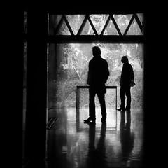 Musée du quai Branly, Paris, France (pas le matin) Tags: people silhouette man homme travel voyage world paris france europe europa nb bw noiretblanc blackandwhite monochrome reflection musée du quai branly muséeduquaibranly quaibranly museum canon 350d canon350d canoneos350d eos350d