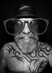 Big Shades. (CWhatPhotos) Tags: cwhatphotos bw mono large sunglasses sun shades glasses digital camera photographs photograph pics pictures pic picture image images foto fotos photography artistic that have which with contain olympus omd em5 mkll fisheye fish eye 8mm pro lens portrait man male smile eyes wide angle beard goatee tattoos tattooed tattoo ink inked tribal bald baldy slap head pork pie hat leather jill corbett