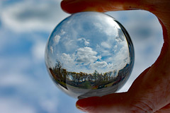 Outdoors In A Lensball. (dccradio) Tags: lumberton nc northcarolina robesoncounty outside outdoor outdoors lensball lensballphotography tensphy sky clouds bluesky march spring springtime nature natural landscape hand finger thumb nikon d40 dslr crystalball glassball glass circle round saturday weekend saturdayafternoon afternoon goodafternoon dumpster trashbin redtruck truck pickup pickuptruck tree trees woods wooded forest parking parkinglot paved pavement