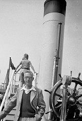 All aboard (vintage ladies) Tags: vintage blackandwhite photograph photo man male boy boat funnel