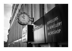 FILM - Jewellers (fishyfish_arcade) Tags: 35mm analogphotography bw blackwhite blackandwhite canonsureshottelemax filmphotography filmisnotdead hp5 istillshootfilm monochrome analogcamera compact film ilford mono clock jewellers