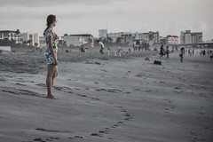 Watching the Sunrise (tim.perdue) Tags: watching sunrise beach florida vacation sand surf shore shoreline atlantic ocean footprints dawn earley morning light girl woman person figure street candid floral dress cocoa