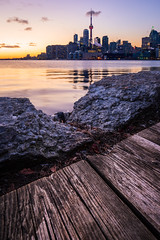 Winter Sunset from the Pier (Brady Baker) Tags: toronto ontario canada polson pier city skyline urban landscape cityscape boardwalk foreground detail calm water lake harbor waterfront tower buildings downtown cntower highrise outdoor sunset dusk goldenhour wide 1635 winter cold
