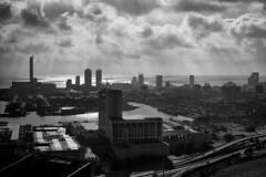 Dark City (Kenneth Laurence Neal) Tags: atlanticcity noir monochrome monotone blackandwhite sky clouds shadows contrast nikon nikond5200 nikon35mmf18 urban cityscape city water ocean buildings street