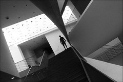 on the brink of darkness (bostankorkulugu) Tags: architecture geometry middleeast holyland israel telaviv museum telavivmuseumofart museumofart man stairs silhouette