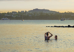 bathers in a hot sunset . . . (Den Rob) Tags: boats volcaniccone trees harbour waitemata buildings sony rx10 m4 reflections red orange goldenhour hotevening settingsun sunset