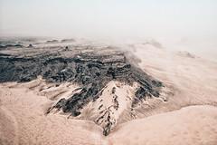 Sand and rocks (A. Shamandour) Tags: saudi arabia alula sand rock desert mountains yellow black storm fog landscape river sunset sunrise hasselblad sky clouds reflections