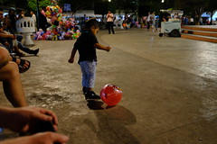 chiquito playing with his ball (zzzweber) Tags: ball boy chico chiquito park square public x100f night