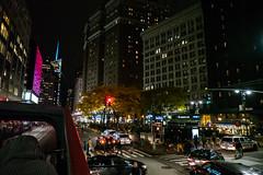 Back to the Lights (Jocey K) Tags: sonydscrx100m6 triptocanadaandnewyork architecture buildings evening illumination nighttourhopandhopoffbus trees autumncolours street road cars traffic bus newyorkcity