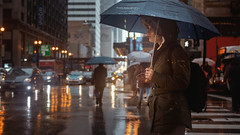 Solitary Moments ☔ (Jovan Jimenez) Tags: canon eos 70d ef 40mm f28 stm people street raining rain umbrella cinematic girl streetphotography chicago city refection