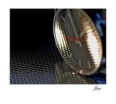 Mondaine (jesse1dog) Tags: macromondays timepiece mondaine watch railway tabletop gm1 russian jupiyer11fatboy 135mm fatboy extensiontubes grille reflection