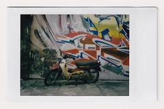 (Hem.Odd) Tags: malaysia kualalumpur motorbike motorcycle graffiti wallpainting wall parked instaxmini90 instant fujifilm