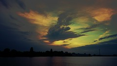 Behind the Clouds (Peter ( phonepics only) Eijkman) Tags: amsterdam zaandam zaanstad zaan zaanstreekwaterland noordzeekanaal water sky sunrise nederland netherlands nederlandse noordholland holland