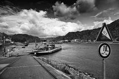 Arrivals (Zoom58.9) Tags: sky clouds hill river water ship ferry street europe germany loreley sony himmel wolken hügel fluss schiff fähre strasse europa deutschland ufer shore monochrome landscape landschaft bw sw
