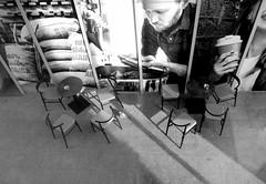 Tchibo Cafe with pidgeon (Zandgaby) Tags: streetphotography tchibocafe monochrome blackandwhite cafe city urban window table chair concrete dove bird shadow bw tiltshiftminiature pidgeon
