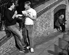Lunch time (Nikonsnapper) Tags: olympus omd em1 zuiko 45mm camden market london street lunch canal men talking eating bw