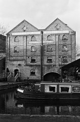Nottingham Canal (stevebeck66) Tags: analogue film 35mm blackwhite ilford hp5 hp5plus monochrome mono bw nottingham olympus om4ti om4 filmslr fellowsmortonclayton wharf canal nottinghamcanal bargeboat canalsidearchitecture millbuilding