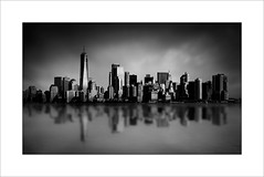 Lower Manhattan Skyline. (tkimages2011) Tags: lower manhattan skyline ny newyork usa america mono monochromatic dark moody sky water river hudson reflection clouds buildings skyscrapers outside outdoor urban architecture