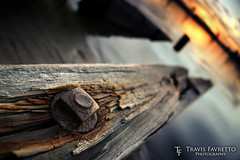 Secured Through the Seasons (tfavretto) Tags: abandoned algoma blur bolt calm channel cracked dawn depthoffield dock dof early focus forgotten glow iron morning reflection rust saultstemarie steel sunrise water weathered wood worn stjosephisland